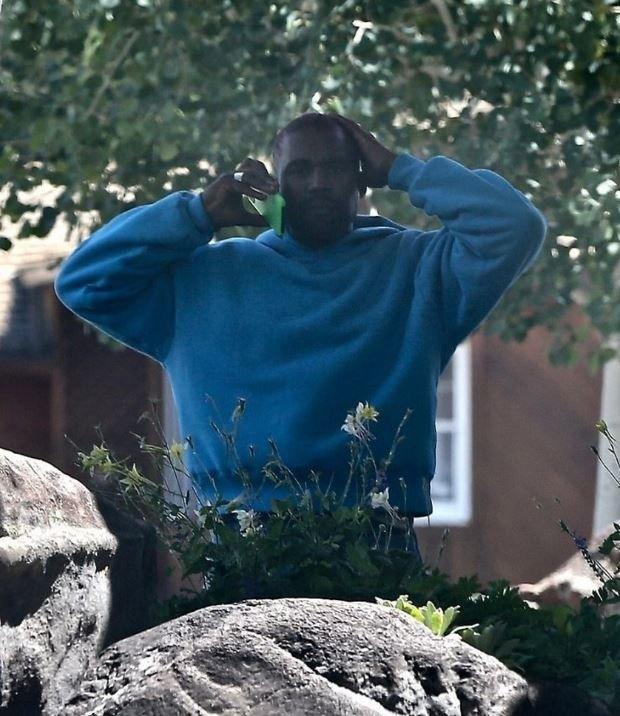 Kanye West in Blue Hoodie