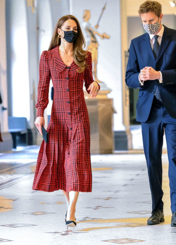 Kate Middleton in a plaid red dress for a visit to a museum in London