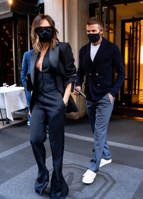 Victoria Beckham in a black suit with David Beckham at a dinner in New York