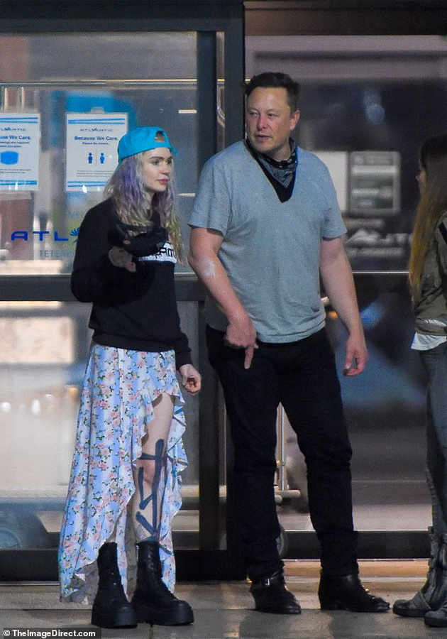 Elon Musk with his wife and little son at the airport