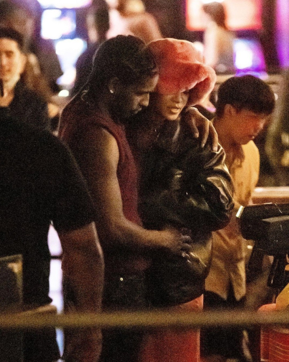 Rihanna in a see-through pink dress with a high slit for going out with boyfriend ASAP Rocky
