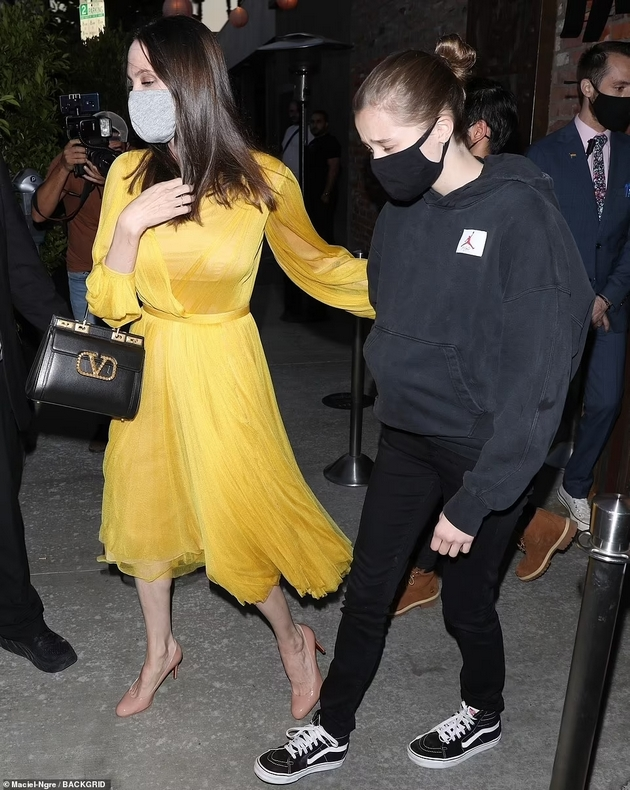 Angelina Jolie at a dinner with the children in a yellow dress for the 46th birthday