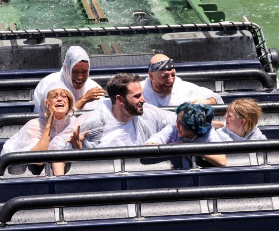 Jennifer Lopez and Ben Affleck smiling and happy with the kids at the amusement park