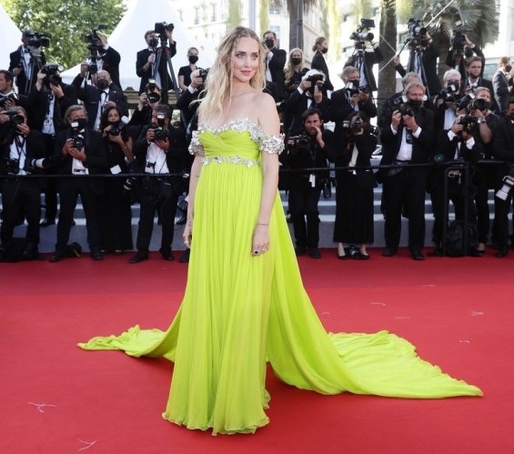 Charming blogger Chiara Ferragni in a light green dress on the red carpet in Cannes