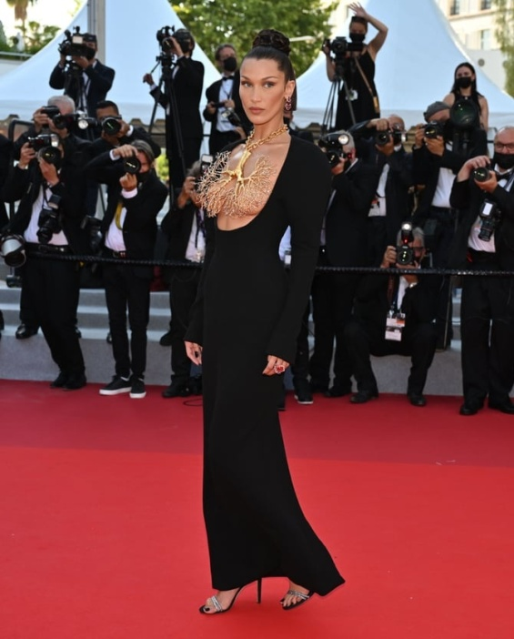 Bella Hadid in a black dress and striking jewelry on her chest at the Cannes Film Festival